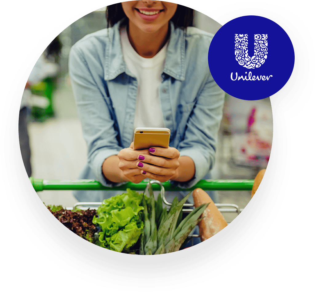 Woman holding her smarthpone smiling Unilever logo